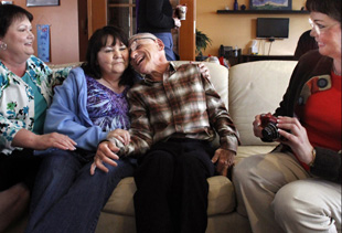 Jerry Wooliver, center right, meets sisters Julie Martin, left, Karen Newman and Janis MacPherson for the first time. Wooliver was born with cerebral palsy and was removed from his mother's home 61 years ago. Martin and MacPherson are twins. (Alan Berner/Seattle Times/MCT)