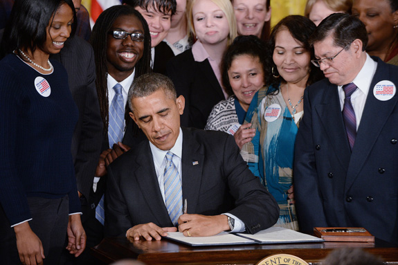 President Barack Obama signs an executive order requiring that workers employed under federal contracts -- including those with disabilities -- be paid at least $10.10 per hour. (Olivier Douliery/Abaca Press/MCT)