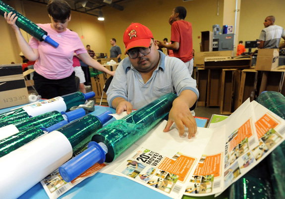Cindy Rankin, 43, left, and Sanjay Singh, 31, put labels on rolls of mover's stretch wrap in the Opportunity Builders, Inc. warehouse in Millersville, Md. where both receive less than minimum wage for their work. A bill moving through Congress would put limits on young people with disabilities entering such jobs. (Kim Hairston/Baltimore Sun/MCT)