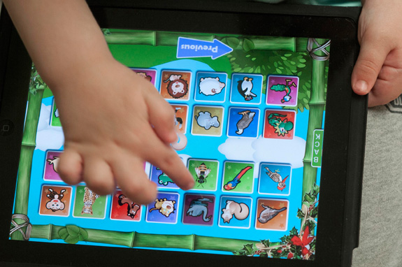 A new study finds that using tablet devices during therapy can help children with autism make greater strides in communication. (John Flavell/Lexington Herald-Leader/MCT)