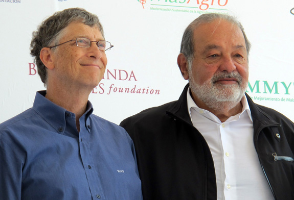 Mexican billionaire Carlos Slim, right, is teaming up with Best Buddies to encourage more businesses to hire people with developmental disabilities. Slim and Bill Gates, left, regularly hold the top two slots on Forbes' list of the world's richest people. (Tim Johnson/MCT)