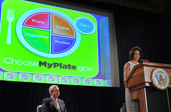 First Lady Michelle Obama and Agriculture Secretary Tom Vilsack, left, unveiled a new healthy eating symbol,