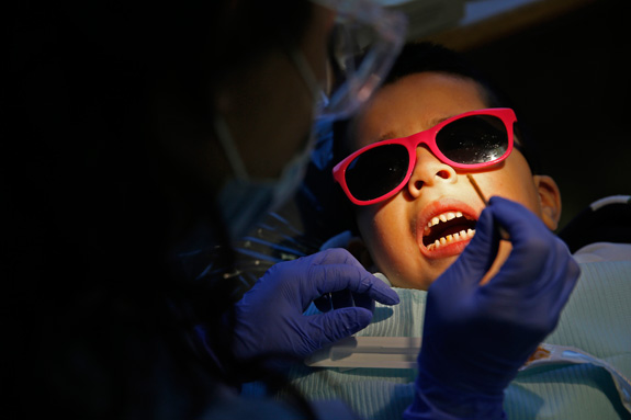 Dentists often rely on restraint and sedation to treat kids with disabilities, but with the right approach, these children are learning the skills to be treated just like other patients. (Jose M. Osorio/Chicago Tribune/MCT)