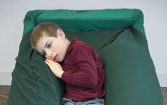 Joshua Jackson, who has autism, finds comfort in the Sensory Lounger. The chair, which is designed to provide a soothing, full-body hug much like Temple Grandin's